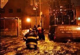 Firefighters waist deep in floodwaters