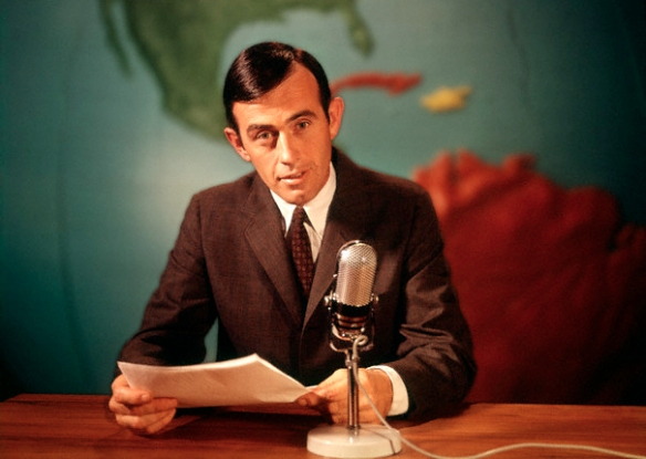 1960s Reporter Reading News Into Microphone With Global Map In Background